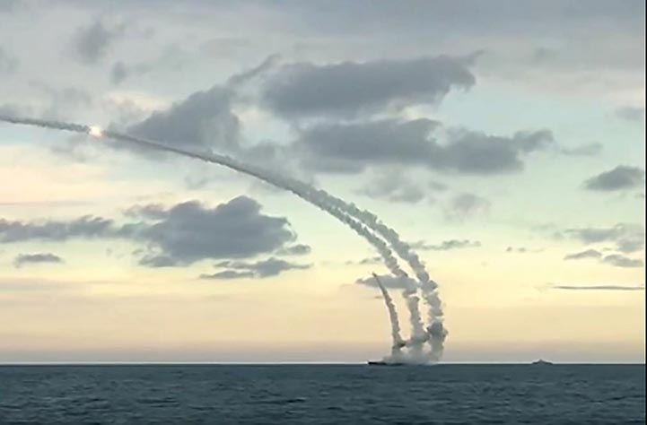 A screenshot of a YouTube video shows cruise missiles being launched 17 November 2015 from a Russian fleet in the Caspian Sea