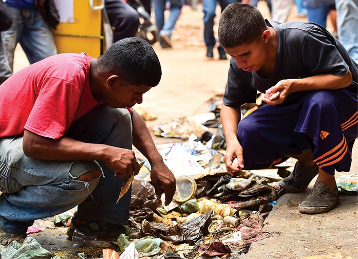 People look for food in garbage