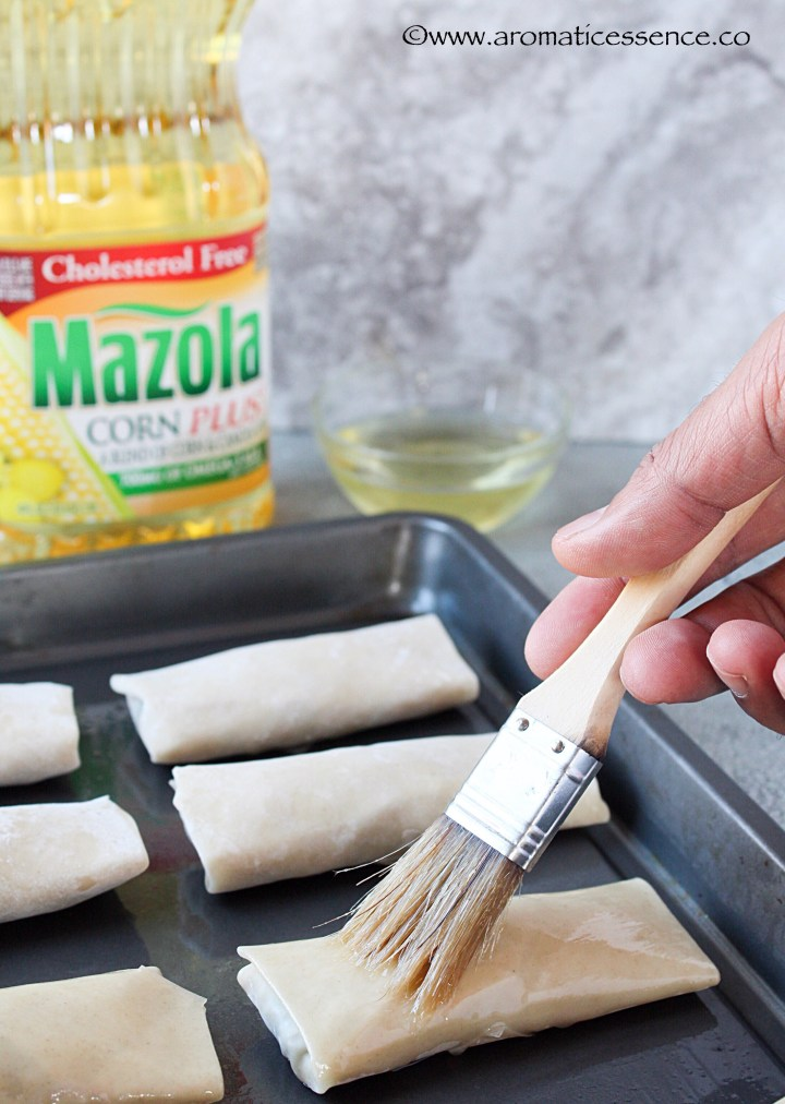 brushing the spring rolls with oil