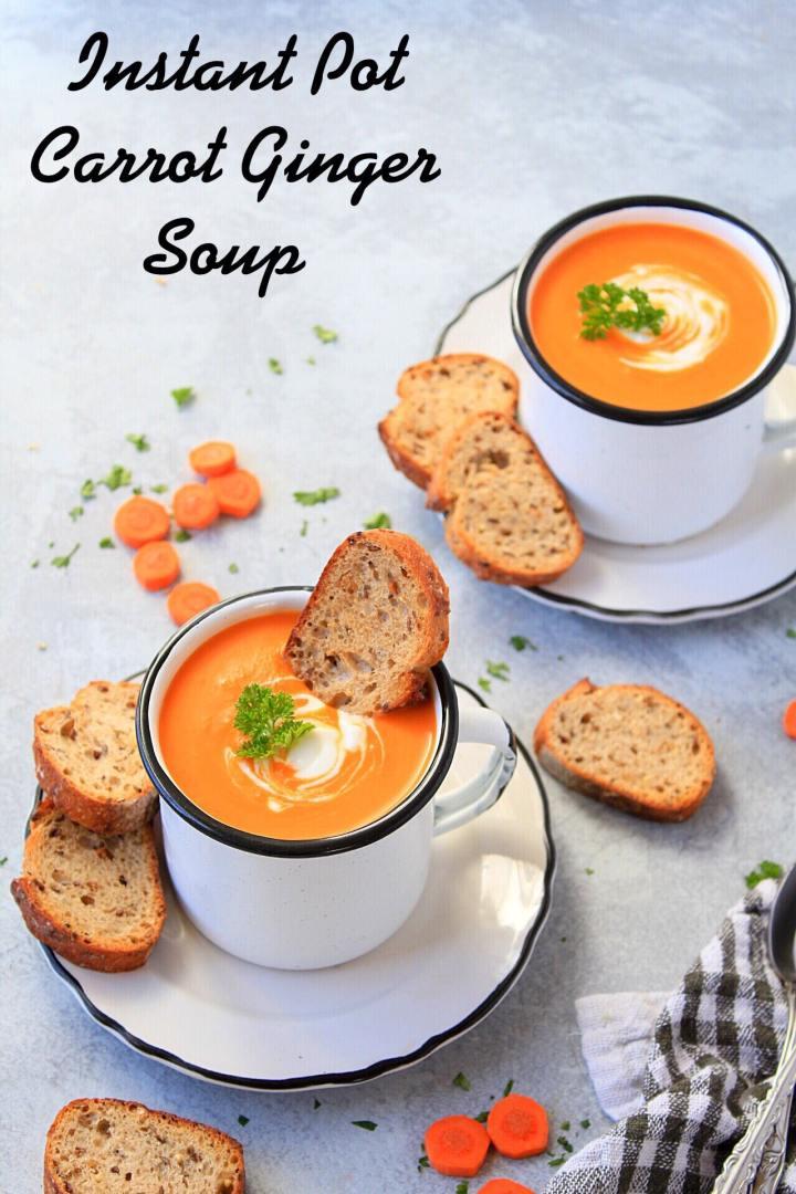 Instant Pot Carrot Soup served in white enamel mugs