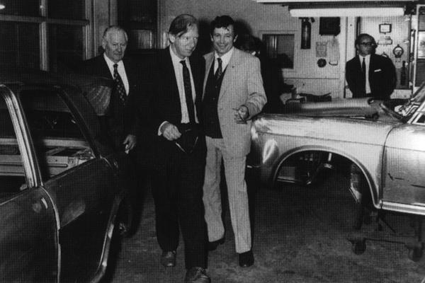Peter Shore (centre) is shown around the Newmarket plant during his tenure as Under-secretary for Economic Affairs (1966-67) in the British Labour government of the day. On the left is Sir Walter Norwood, head of the family-owned Dominion Motors, and they are flanked by a couple of 1100 bodyshells mounted on jigs during the assembly process.