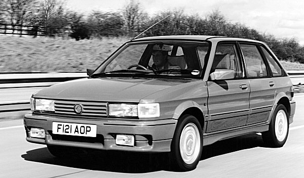MG Maestro Turbo in flight: A recipient of the Montego Turbo's power unit in 1988, the MG proved to be very quick in a straight line. Chassis was not bad, either, if lacking the ultimate finesse of its Peugeot and Citroën rivals. The bodykit, designed by Tickford, is of questionable taste.