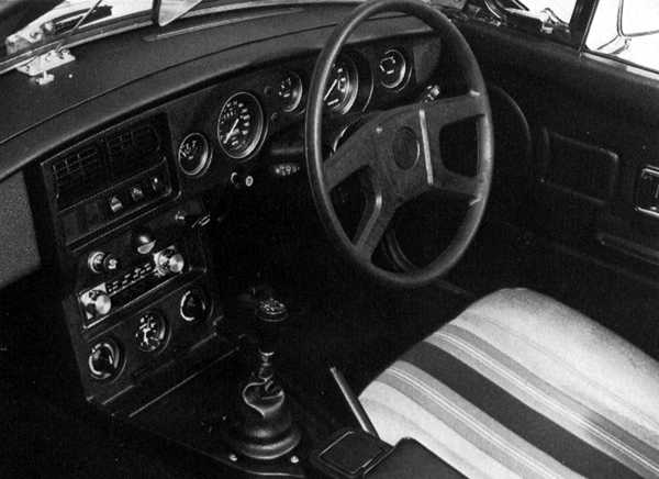 Late model MGB GT interior shows a no-nonsense approach... the stripy seats were very much of their time