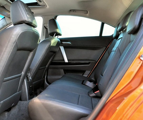 Rear seat legroom is class competitive, but the headroom suffers due to sloping roofline.