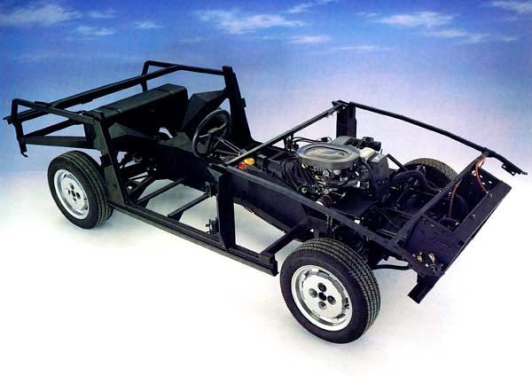 The SS1 chassis, fabricated by Thyssen in West Germany, combined a stiff Lotus-like central backbone with large subframes to support the unstressed body panels. Note the angle of the front dampers.