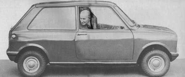 Issigonis seen here in his masterpiece: he shows that, unlike the original Mini, the side windows slid enough to allow the driver to poke his head out for a better view when reversing.
