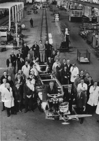 A group of Jaguar Daimler workers gather around the last Coventry built Fleetline in September 1973.