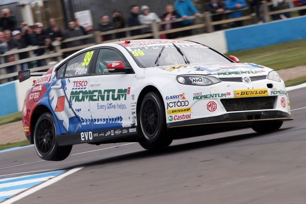 Jason Plato's MG6 GT flying over the kerbs during Round 6 at Donington Park