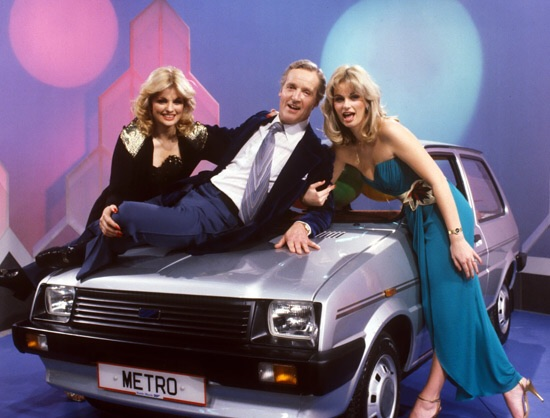 Carole Ashby / Nicholas Parsons & Karen Loughlin pose with the Star Prize. SOTC was in fact the first UK game show to offer a car as a top prize. Towards the end of the show they tended to be Mini's or Mini Metro's supplied from the local Mann Egerton dealer that was 100 yards down the road from the studio. (Pic: ITV Anglia)