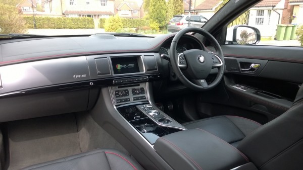 "Leather and piano black in abundance. Front seats are wing backed with heating and air conditioning that feature a neat ""RS"" embossment in the leather."