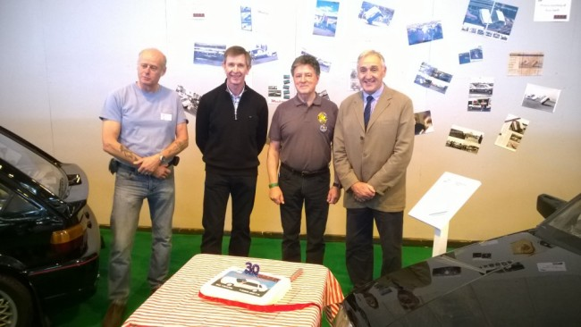 Jeff Patterson, Kevin Jones, Denis Chick and Russ Swift prepare to cut the birthday cake for the MG Montego Turbo 30th.
