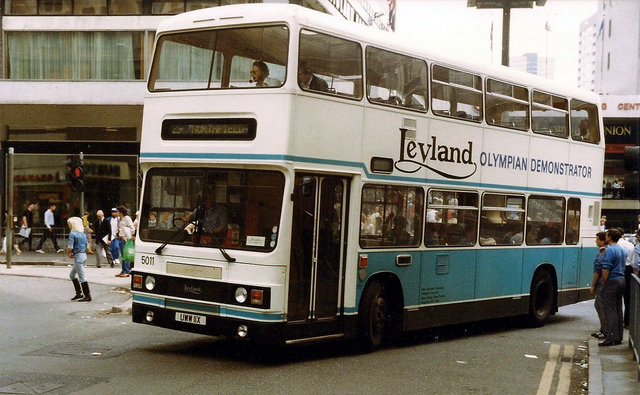 A Leyland demonstrator threads its way through Birmingham City centre.
