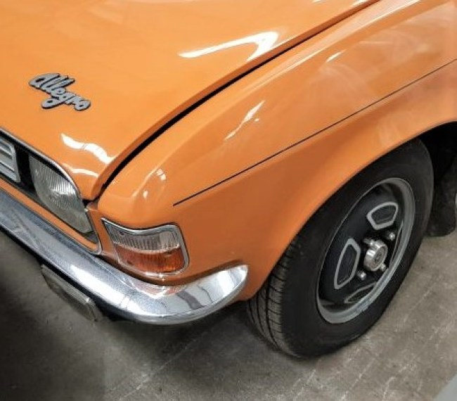 1974 Austin Allegro 1750 Sport (twin carb). Distinctive wheel trims on pressed steel wheels. This car has the bonnet ajar - the shut lines were better than that : )