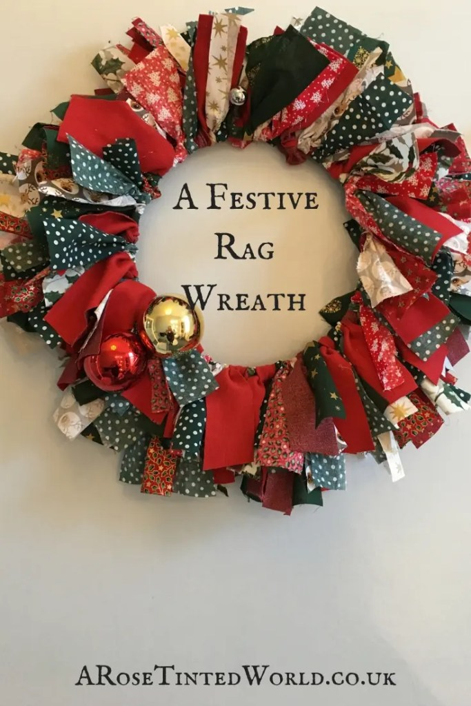 A festive rag wreath - DIY craft Shabby Chic Christmas Decoration that is frugal. Great gift. Holiday and Xmas ideas. #christmascrafts #christmasdecorations #christmaswreath #christmaswreathsdiy #frugallivingideas #christmasdiy #christmasdecor #wreaths #wreathdecorations #wreathdiy #zerowaste #zerowastexmas #diychristmas #sustainablechristmas #sustainability
