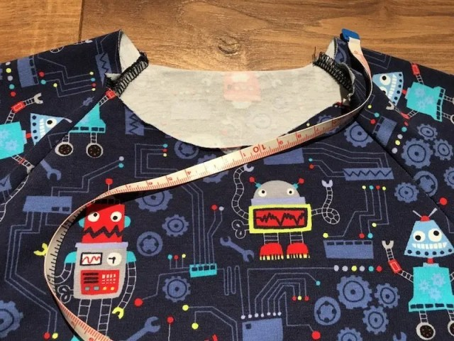 How To Sew A Neck Band Into A Stretch Garment - measuring the neckband opening
