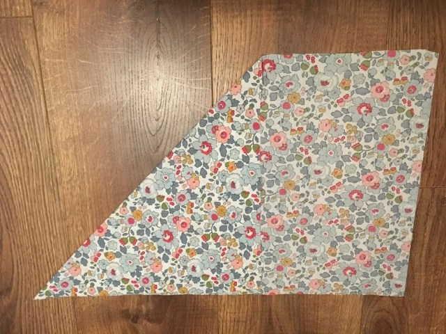 Corner of fabric folded to other edge
