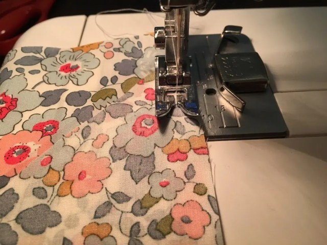 Sewing the seam using the presser foot as a guide