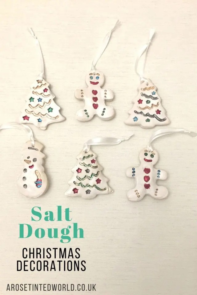 Salt Dough Christmas Decorations are a cheap and easy way of making lovely Xmas bauble ornaments using store cupboard ingredients every home will have. Great idea to gift or keep. Find out how we made ours. #christmas #christmasdecor #christmasdecorations #christmasideas #christmasornaments #christmasdiy #christmasdecorationsdiy #christmasdecorationsideas #christmasdecordiy #christmasideasforkids #saltdough #saltdoughornaments #childrenscrafts