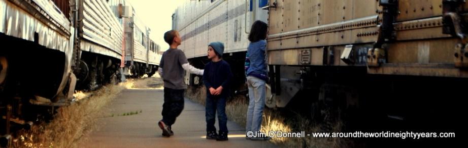 Cousins jumping trains. Pueblo, Colorado. USA