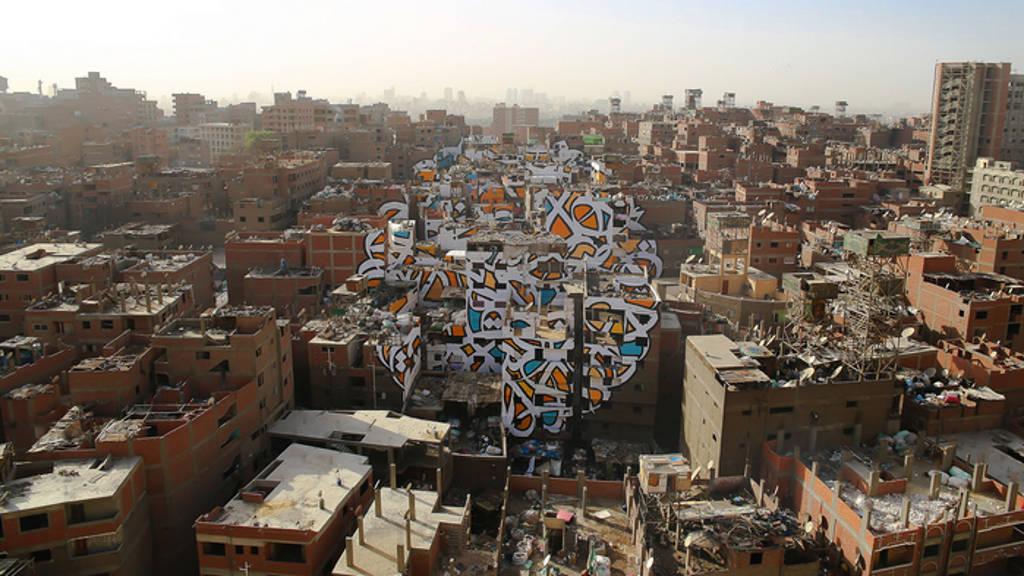 Resultat d'imatges de Proyecto de los artistas El Seed y TED Fellow en Manshiyat Naser, un distrito de El Cairo, Egipto