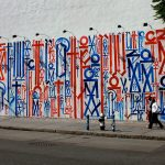 retna street art blue and red graffiti side of building
