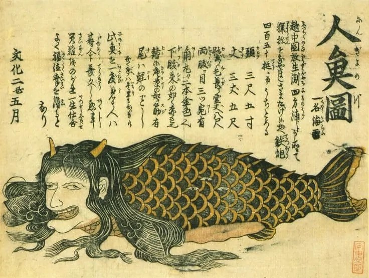 print of a mermaid like creature with Japanese writing