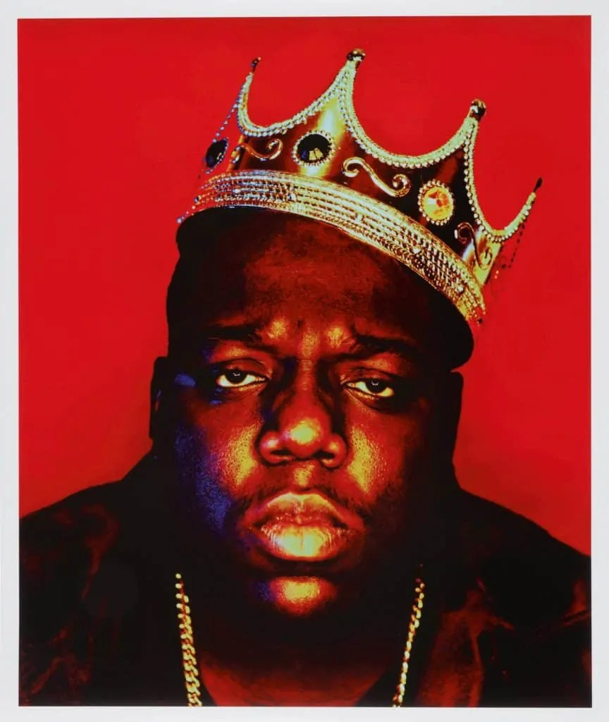 red, black, and gold image of rapper Notorious B.I.G. wearing a plastic crown Art World Roundup