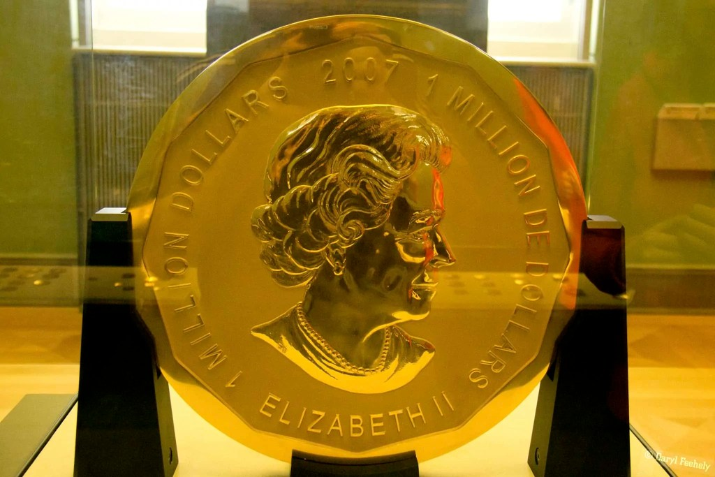 Large gold coin with the queen's profile on it
