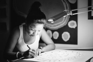 Jacky Cheng at work in her studio in Broome, Australia
