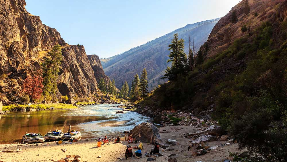 A campsite along the river while whitewater rafting on the Middle Fork Salmon River in Idaho with ARTA river trips