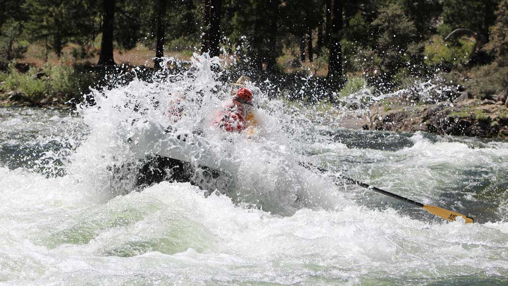 A raft runs Marble Creek rapid while whitewater rafting on the Middle Fork Salmon River in Idaho with ARTA river trips