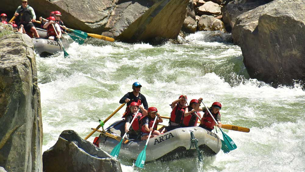 Two oar-paddle rafts in the middle of Split Rock rapid while whitewater rafting on the Merced River in California with ARTA river trips