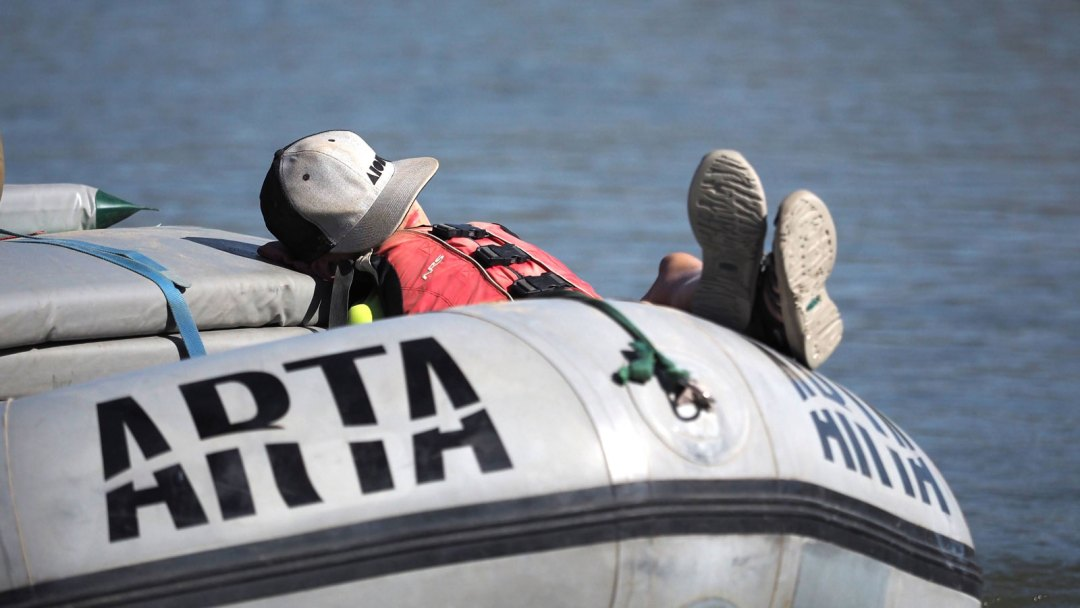 Taking a nap in the raft
