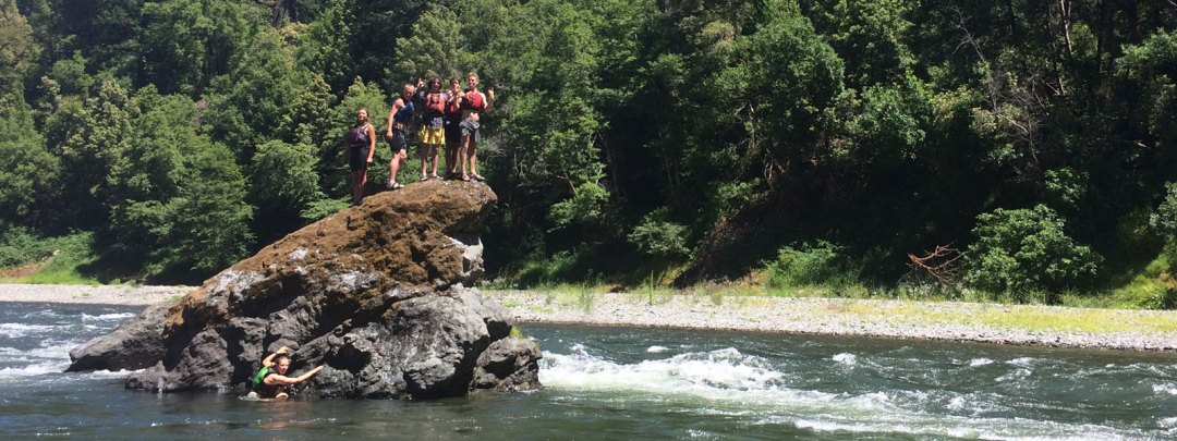 Kids on a rock in the Rogue River in Oregon