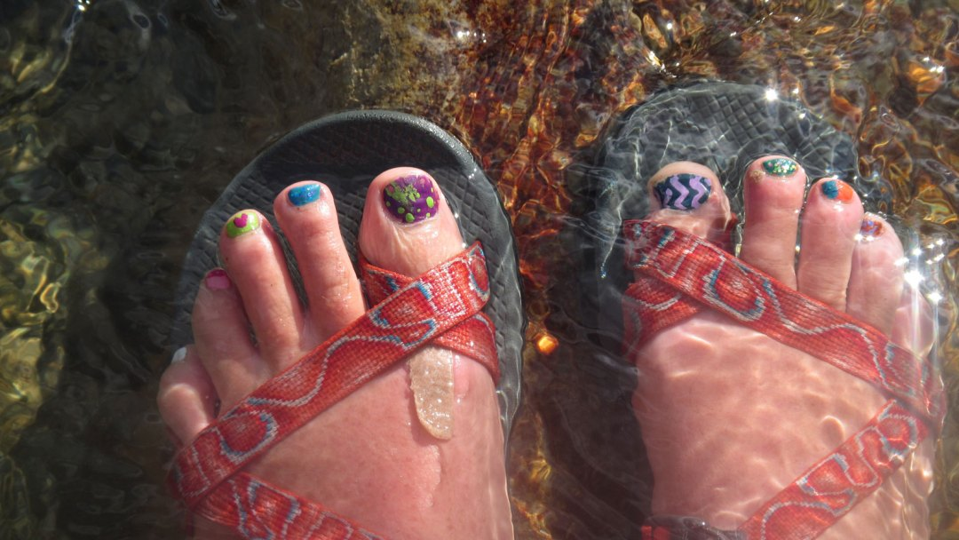 painted toenail and sandals arta river trips
