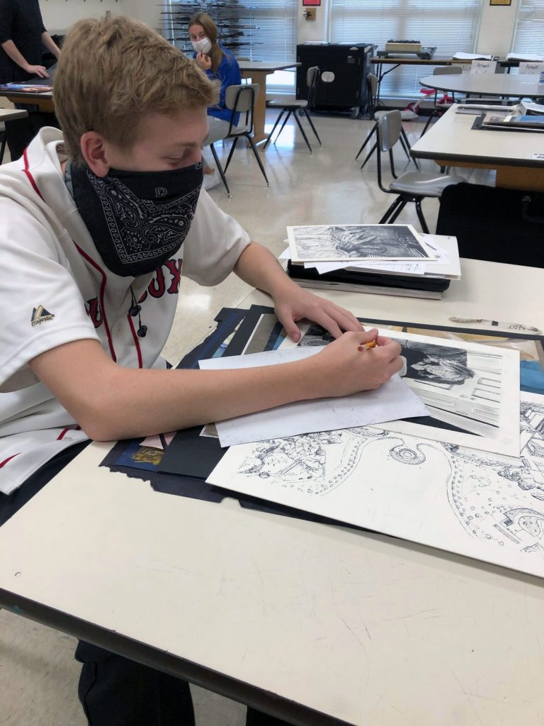 A student working on a drawing.