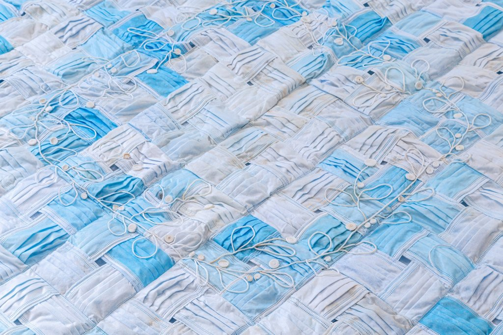 A close up of a quilt made of PPE.