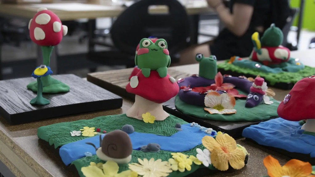 A photo of clay sculptures made by students at Camp Art Academt.