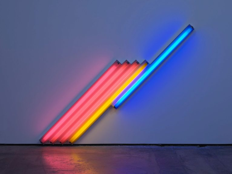 "Dan Flavin, ""Untitled (for Frederika and Ian) 3"", (1987), Pink, yellow, and blue fluorescent light – 183 cm long on the diagonal, 72 1/8 in long on the diagonal – Edition 2 of 5 © 2018 Estate of Dan Flavin / Artists Rights Society (ARS), New York. (Courtesy: David Zwirner & Cardi Gallery)"