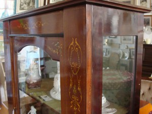 Painted decoration on display cabinet