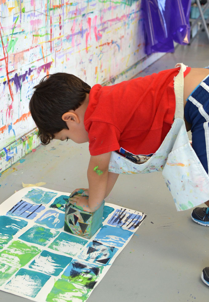 Collagraph printing with kids using wooden blocks to create a quilt pattern.