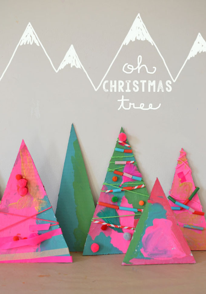 Children make process-art Christmas trees with paint and some collage materials.