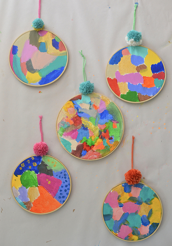 Kids make these gorgeous acrylic round paintings by studying artist Kindah Khalidy.