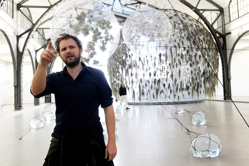 Argentinian artist Tomas Saraceno poses at his exhibition 'Cloud Cities' at the Museum for Contemporary Art at Hamburger Bahnhof in Berlin, Germany. The exhibition of the installation artist shows around 20 balloon modules, which can be entered by the visitors. The exhibition runs until 15 January 2012. EPA/MAURIZIO GAMBARINI.