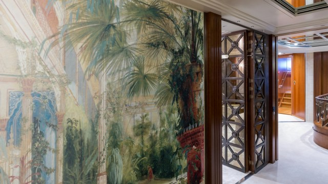 Luxurious garden mural with palm trees in a tropical plantation setting