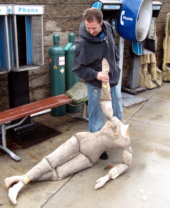 movie prop technician drags decapitated dummy around