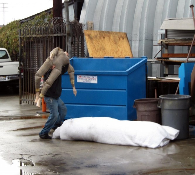 decapitated dummy heaved into dumpster
