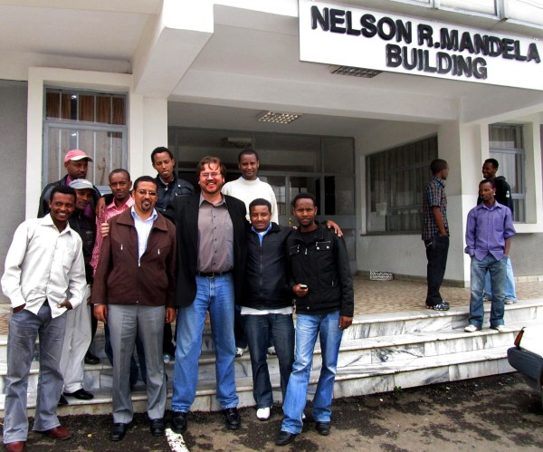dave lafontaine and his tv production class in front of the nelson mandela building at addis ababa university