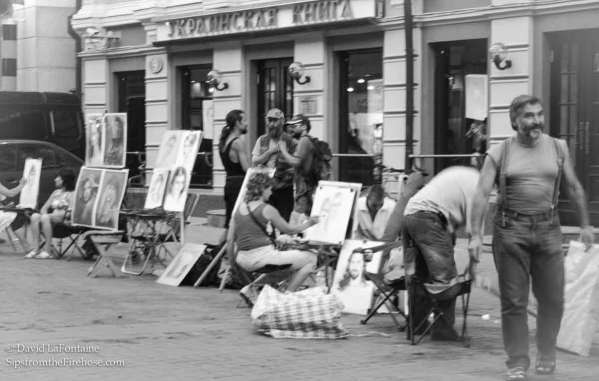 Russian artists painting portraits in the street