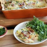 A Serving of Smoky Scalloped Potatoes with Ham and Chives Artful Dishes